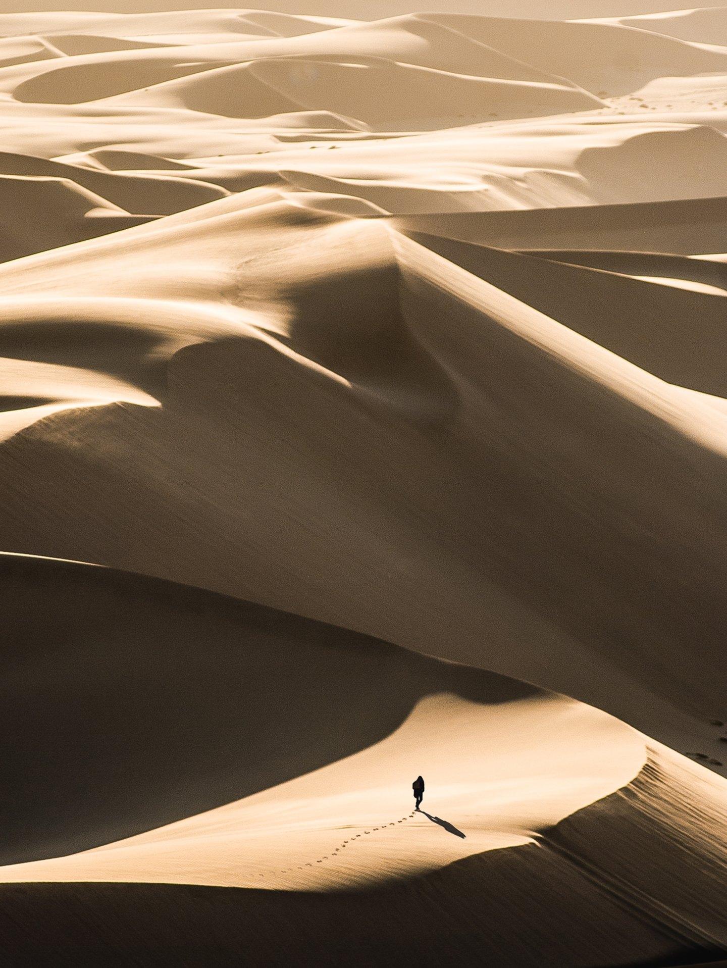 Person walking along through the desert
