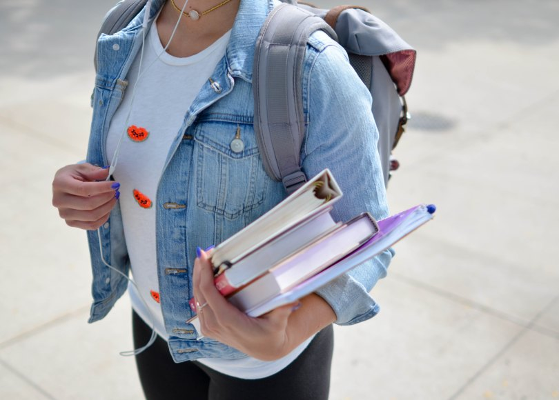 Girl carrying her school books