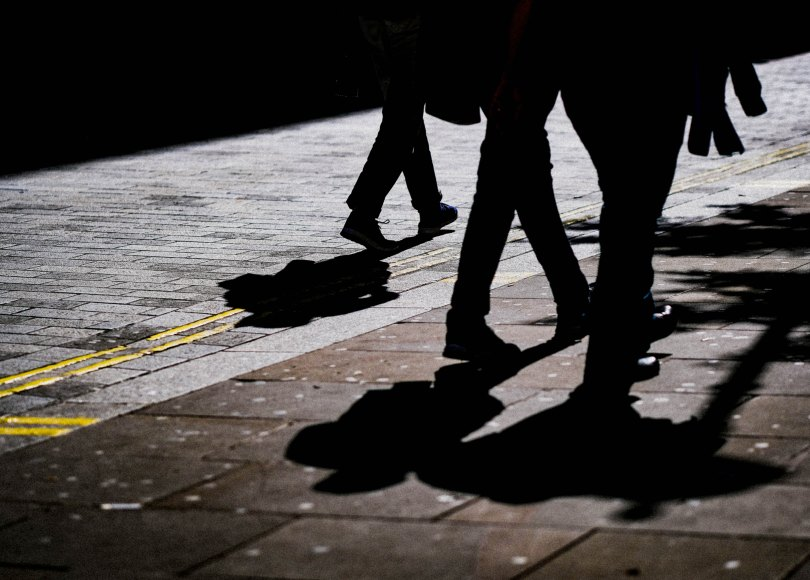 Three men walking together