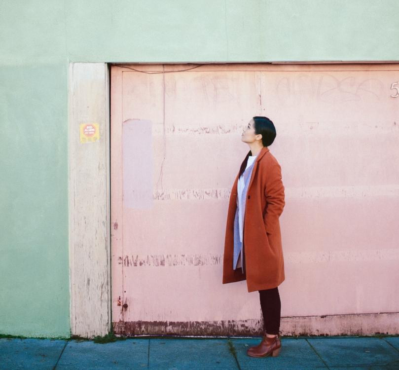 Woman looking at a wall