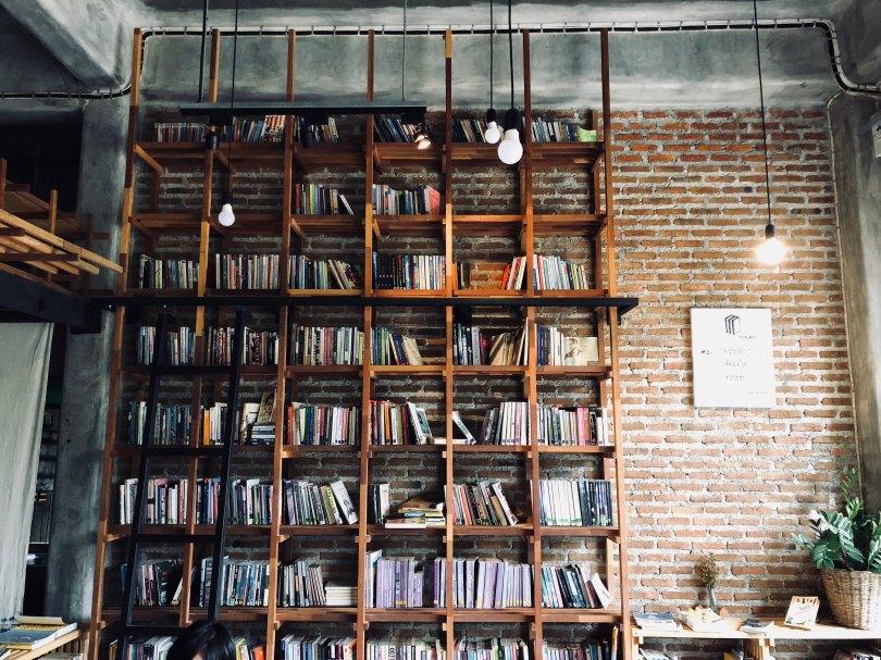 Bookshelf with brick wall and hanging lights