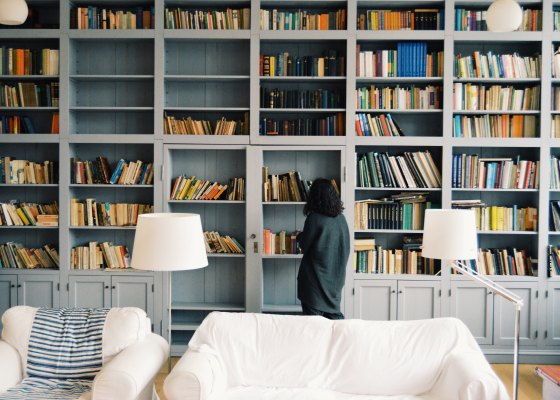 Woman looking through her library