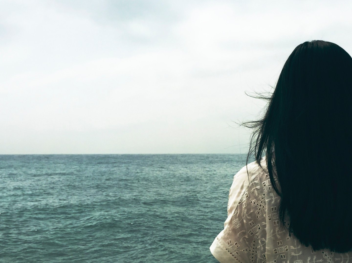 Woman looking out at the sea