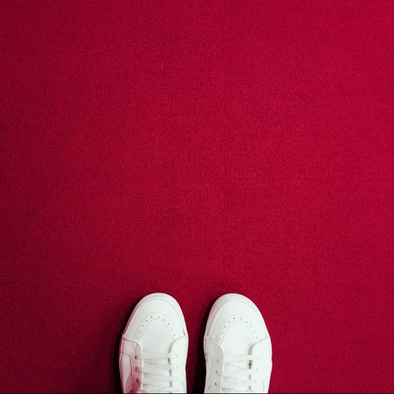 White shoes on red carpet
