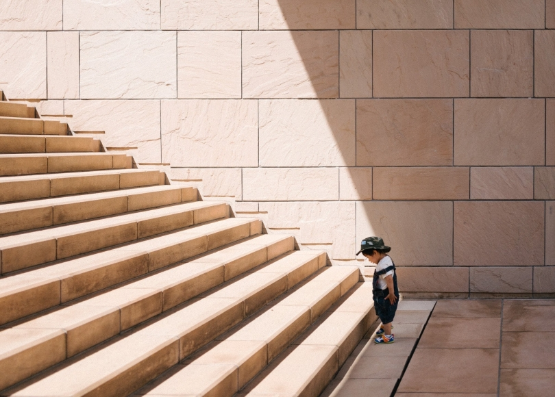 Toddler staring at a staircase