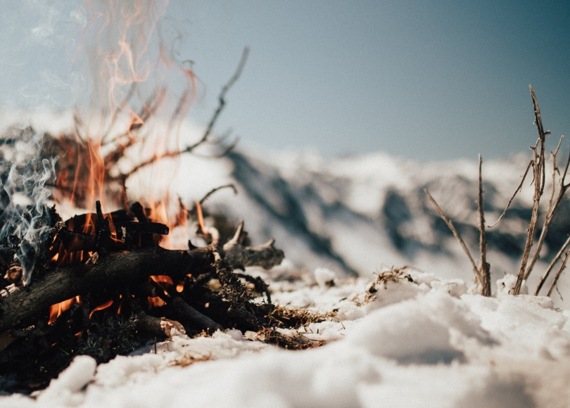 A fire burning in snow