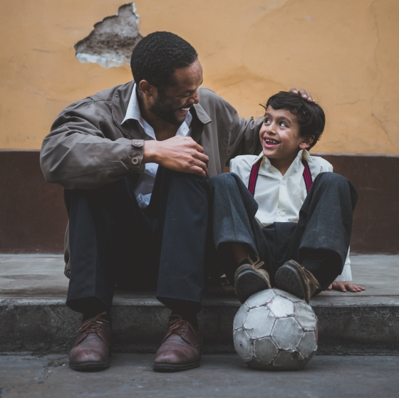 Man and boy smiling and laughing