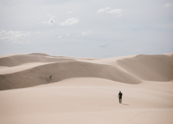 Person walking alone in the desert