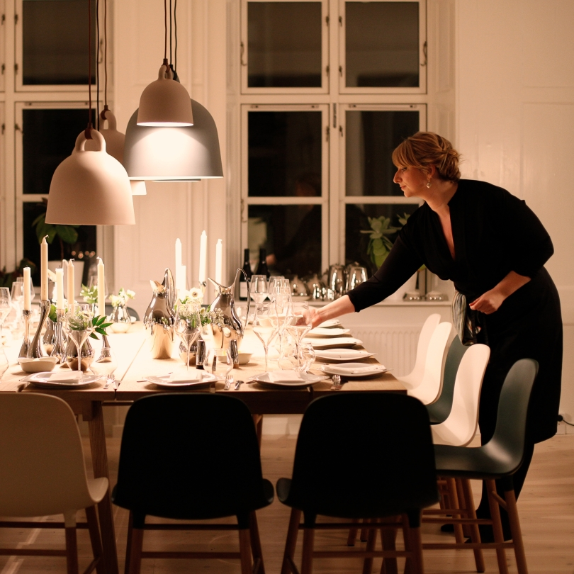 Woman setting the table for dinner