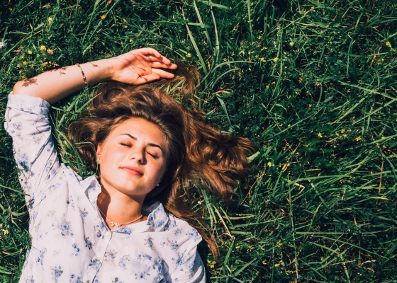 Person lying in grass