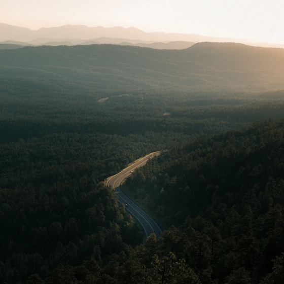 View from the mountains onto a winding road