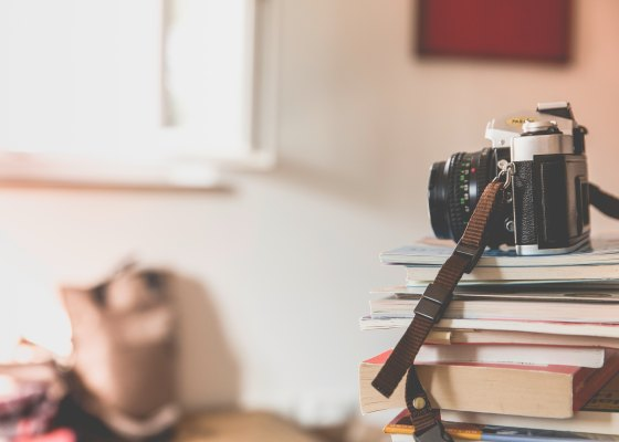 Camera sitting on a stack of books