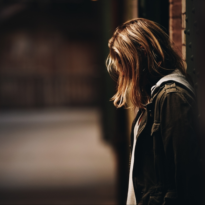 Woman looking down in an alley