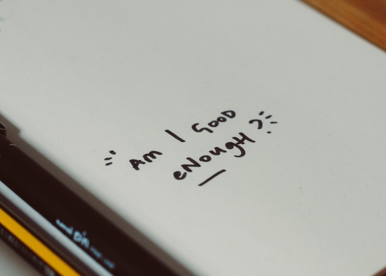 """Notebook with """"am I good enough?"""" written on it"""