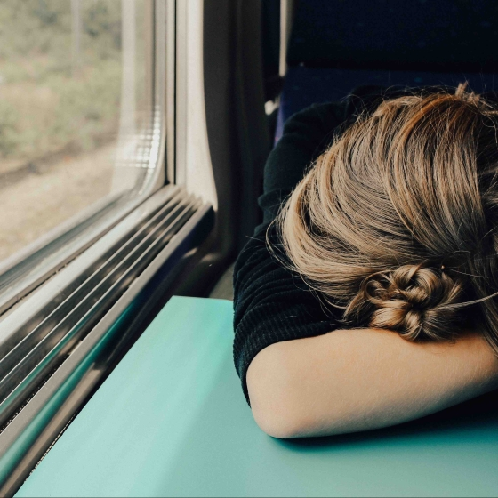 Exhausted woman on a train