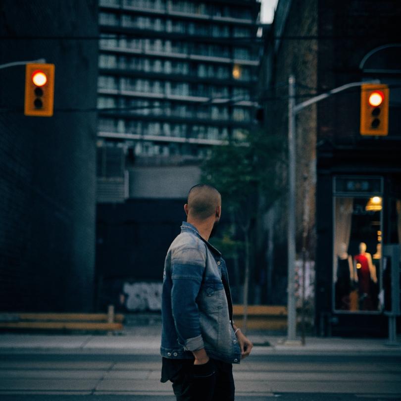 Man look at stop lights