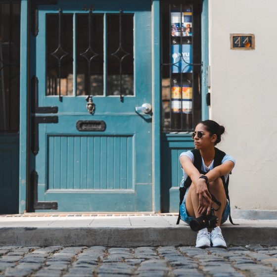 Girl sitting on a step